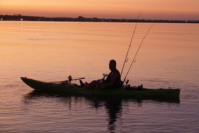 A kayak fisherman with the best kayak fishing accessories