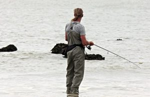 An angler wearing some of the best bib and braces